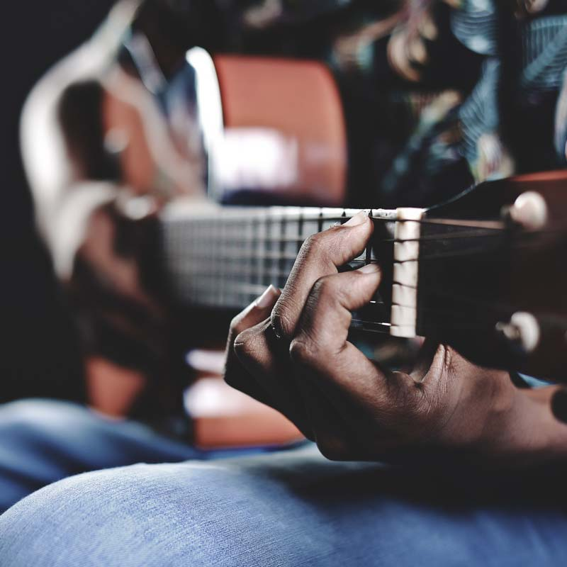 Image of a person playing guitar
