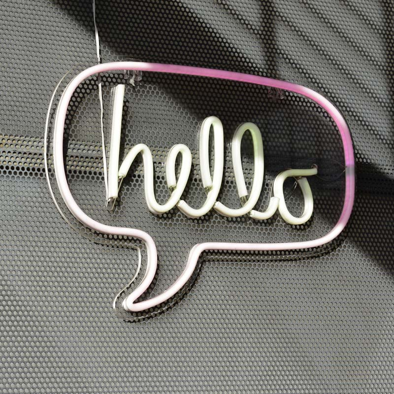 image of a neon sign that reads hello