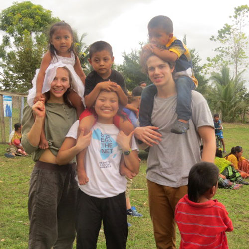 image of a group of youth with children in a foreign country