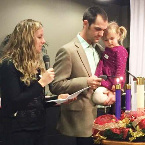 Image of the Pinches family lighting an Advent wreath