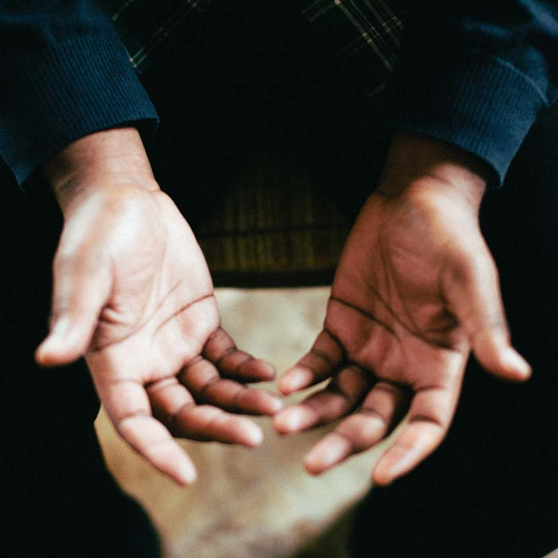 image of hands opened in prayer